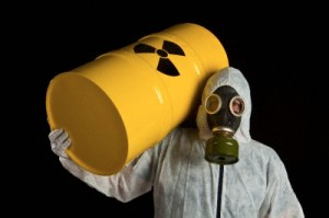 A Person Carrying A Radioactive Barrel And Wearing Protective Clothing