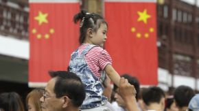 Wall St. elites reason it's time for a 'de-Americanized world,' China's news agencysays